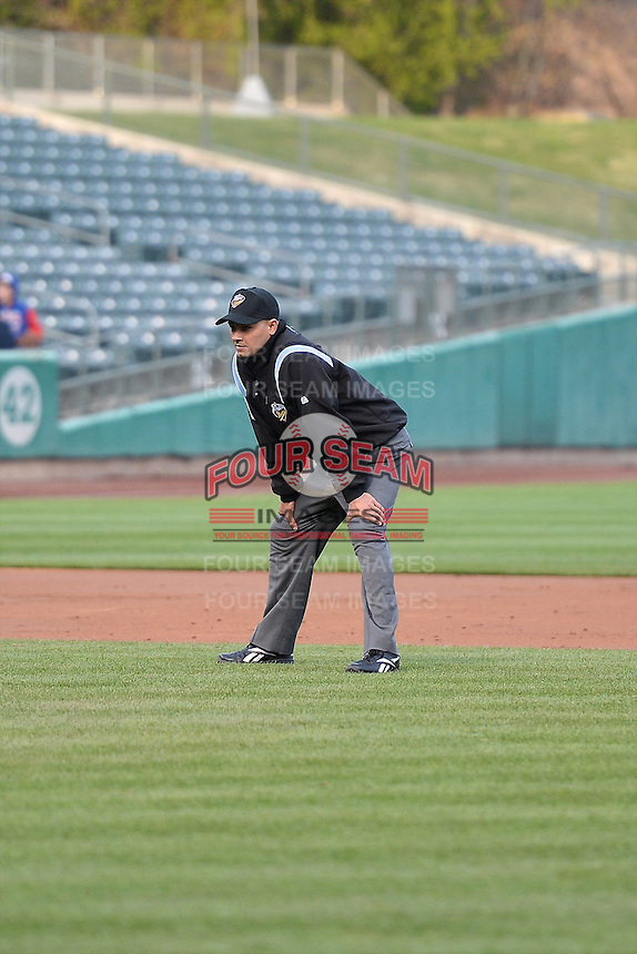 Base umpire Roberto Ortiz during the game as the Sacramento River Cats faced the Salt Lake Bees in Pacific Coast League action at Smith's Ballpark on April 3, 2014 in Salt Lake City, Utah.  (Stephen Smith/Four Seam Images)