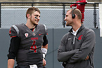 A pair of great Cougar quarterbacks, Luke Falk and Alex Brink, talk shop on the sidelines during the annual Washington State Cougar spring game, the Crimson and Gray game, at Joe Albi Stadium in Spokane, Washington, on April 23, 2016.