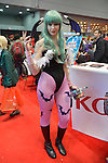 Manhattan, New York City, New York, USA. October 10, 2015. Cosplayer MISSISSIPPI has batwings, green hair, and pink tights with black bats on them, at the 10th Annual New York Comic Con. NYCC 2015 is expected to be the biggest one ever, with over 160,000 attending during the 4 day ReedPOP event, from October 8 through Oct 11, at Javits Center in Manhattan