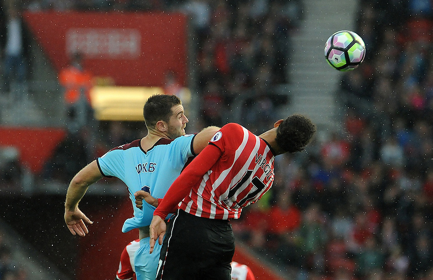 Burnley's Sam Vokes and Southampton's Virgil van Dijk challenge for the header <br /> <br /> Photographer Ian Cook/CameraSport<br /> <br /> The Premier League - Southampton v Burnley - Sunday 16th October 2016 - St Mary's Stadium - Southampton<br /> <br /> World Copyright &copy; 2016 CameraSport. All rights reserved. 43 Linden Ave. Countesthorpe. Leicester. England. LE8 5PG - Tel: +44 (0) 116 277 4147 - admin@camerasport.com - www.camerasport.com