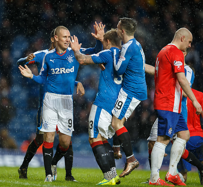 Martyn Waghorn congratulated by Kenny Miller, Gedion Zelalem and Barrie McKay