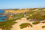 Woman walking Rota Vicentina, near Zambujeira do Mar, Alentejo Littoral, Portugal, Southern Europe