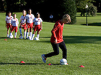 USWNT midfielder Lori Lindsey leads a drill during a Lets Move! soccer clinic held on the South Lawn of the White House.  Let's Move! was started by Mrs. Obama as a way to promote a healthier lifestyle in children across the country.