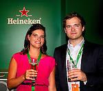 Engeland, London, 26 juli 2012.Olympische Spelen London.Opening Holland Heineken House.Anke de Carvalho De Dochter van Charlene de Carvalho-Heineken met een Heineken Biertje en haar parner
