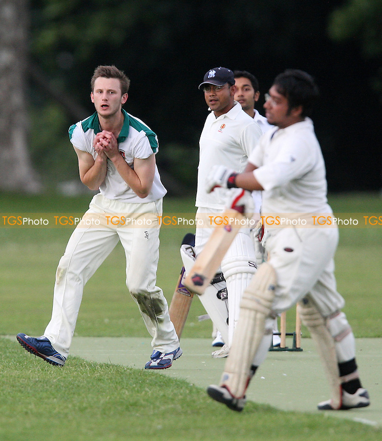 Will Isaac of London Fields completes the caught and bowled dismissal of New Boys batsman Tamim (right) - New Boys CC vs London Fields CC - Victoria Park Community Cricket League - 14/07/08 - MANDATORY CREDIT: Gavin Ellis/TGSPHOTO - Self billing applies where appropriate - Tel: 0845 094 6026.