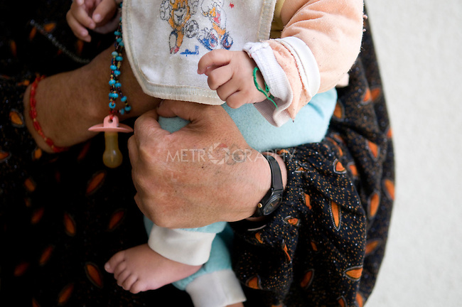 SULAIMANIA, IRAQ: A female detainee holds her one-year old baby while meeting with Rezan. She is accused of killing her husband who severely abused.