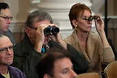Members of the public use binoculars as they watch the United States House Judiciary Committee hearing on the impeachment of US President Donald Trump on Capitol Hill in Washington, DC, December 4, 2019.<br /> Credit: Saul Loeb / Pool via CNP