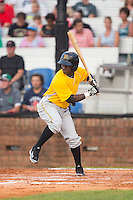 Carlos Ozuna (3) of the Bristol Pirates at bat against the Johnson City Cardinals at Howard Johnson Field at Cardinal Park on July 6, 2015 in Johnson City, Tennessee.  The Cardinals defeated the Pirates 8-2 in game two of a double-header. (Brian Westerholt/Four Seam Images)