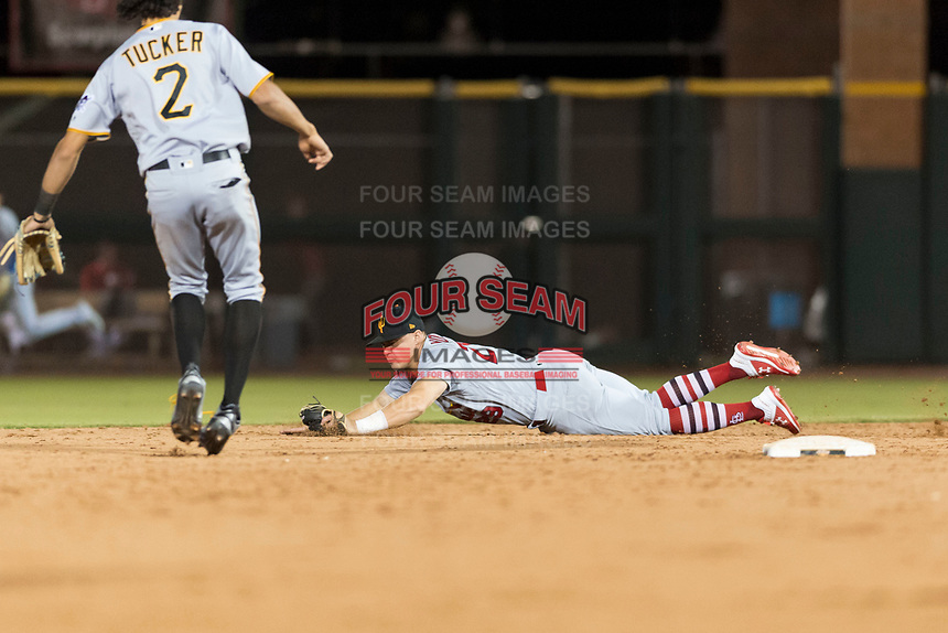 Surprise Saguaros second baseman Andy Young (29), of the St. Louis Cardinals organization, makes a diving play in front of Cole Tucker (2) during an Arizona Fall League game against the Scottsdale Scorpions at Scottsdale Stadium on October 15, 2018 in Scottsdale, Arizona. Surprise defeated Scottsdale 2-0. (Zachary Lucy/Four Seam Images)