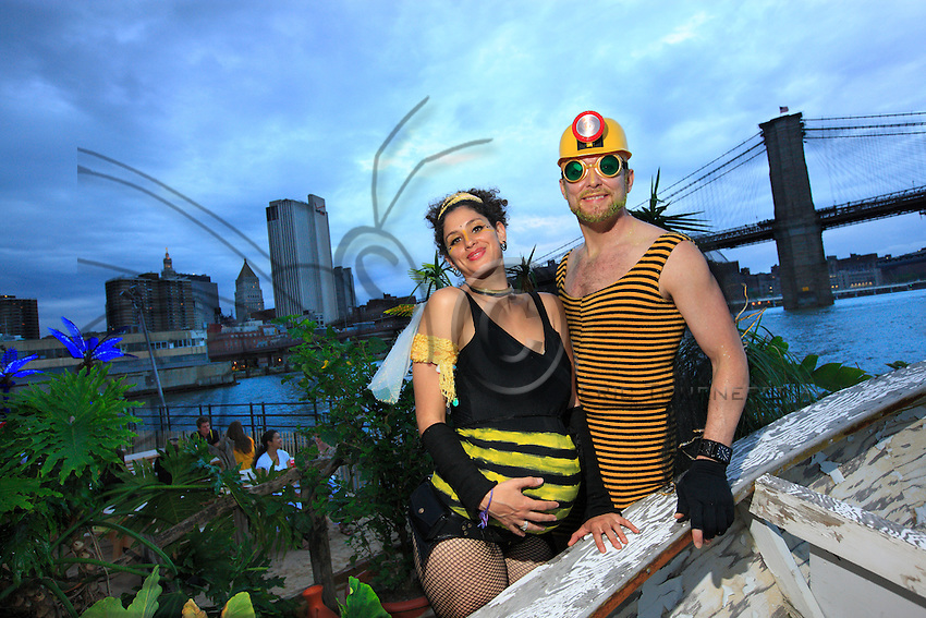 The beekeepers ball organized by the organization Justfood.org took place on Monday evening, June 22, 2009 at the Water Taxi Beach on the South Street Seaport, opening Pollination Week in New York. All bee enthusiasts, beekeepers, wannabe beekeepers and New York farming families got together for a costume ball.