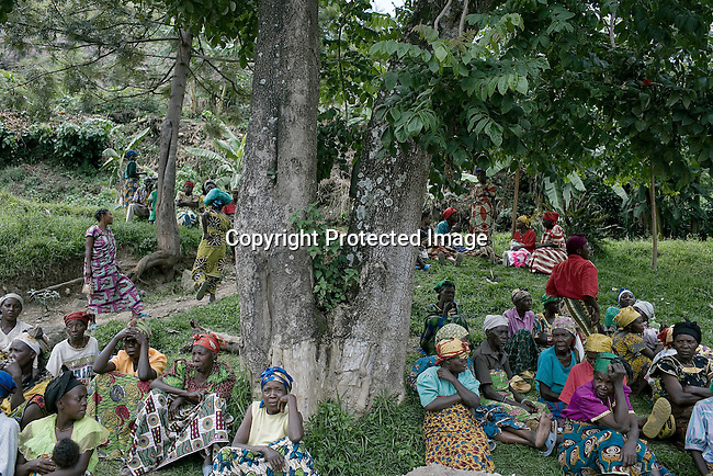 BUKAVU, DEMOCRATIC REPUBLIC OF CONGO - OCTOBER 31: Women and a girl wait to be attended to on October 31, 2007 outside a clinic in rural Bushushu, DRC. Many of the women visiting the clinic has been raped and abused by rebels and government soldiers. Today a Doctor and a nurse visit from Panzi hospital in Bukavu to interview and refer woman, if needed. The DRC conflict has seen an unprecedented high rate of rape and sexual abuse of women. The culprits are both different rebel groups and government soldiers and very few are punished. About 27,000 sexual assaults were reported in South Kivu province alone in 2006, according to the United Nations. (Photo by Per-Anders Pettersson).