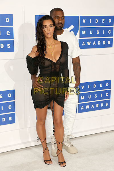 NEW YORK - AUGUST 28: Kanye West and Kim Kardashian West arrive at the 2016 MTV Video Music Awards at Madison Square Garden on August 28, 2016 in New York City.<br /> CAP/MPI99<br /> &copy;MPI99/Capital Pictures