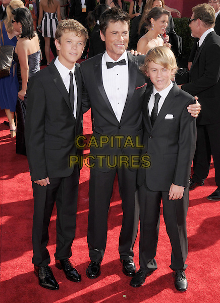 ROB LOWE & SONS .Arrivals at the 61st Primetime Emmy Awards held at Te Nokia Theater in Los Angeles, California, USA..September 20st, 2009     .emmys full length black suti tuxedo father dad kids children family .CAP/DVS.©Debbie VanStory/Capital Pictures.