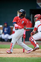 New Hampshire Fisher Cats third baseman Vladimir Guerrero Jr. (27) follows through on a swing in front of catcher Taylor Gushue (36) during the first game of a doubleheader against the Harrisburg Senators on May 13, 2018 at FNB Field in Harrisburg, Pennsylvania.  New Hampshire defeated Harrisburg 6-1.  (Mike Janes/Four Seam Images)