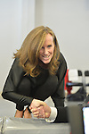 "Westbury, New York, USA. January 15, 2017. Representative KATHLEEN RICE (Democrat - 4th Congressional District NY) bends down on stage to shake hands with members of the public at end of the ""Our First Stand"" Rally against Republicans repealing the Affordable Care Act, ACA, taking millions of people off health insurance, making massive cuts to Medicaid, and defunding Palnned Parenthood. Hosts were Reps. Rice and Thomas Suozzi (Dem. - 3rd Congress. Dist.). It was one of dozens of Bernie Sanders' nationwide rallies for health care that Sunday."