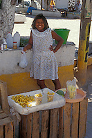 Girl selling fruit snacks in the town of San Blas, Nayarit. Mexico
