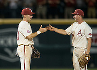 NWA Democrat-Gazette/BEN GOFF @NWABENGOFF<br /> Carson Shaddy (left), Arkansas second baseman, and Jax Biggers, Arkansas shortstop, celebrate Saturday, June 9, 2018, after defeating South Carolina 9-3 in game one of the NCAA Super Regional at Baum Stadium in Fayetteville.