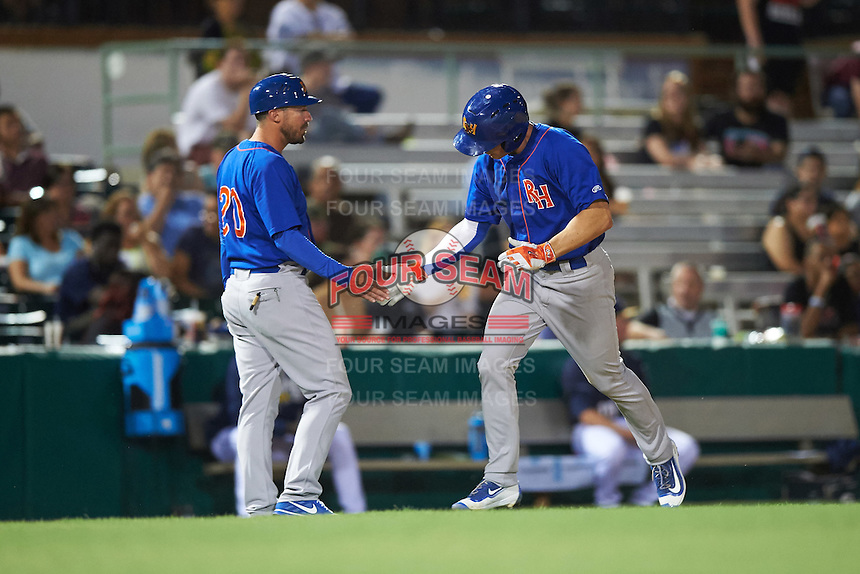 Midland RockHounds third baseman Matt Chapman (7) is congratulated by manager Ryan Christenson (20) after hitting a home run during a game against the San Antonio Missions on April 21, 2016 at Nelson W. Wolff Municipal Stadium in San Antonio, Texas.  Midland defeated San Antonio 9-2.  (Mike Janes/Four Seam Images)