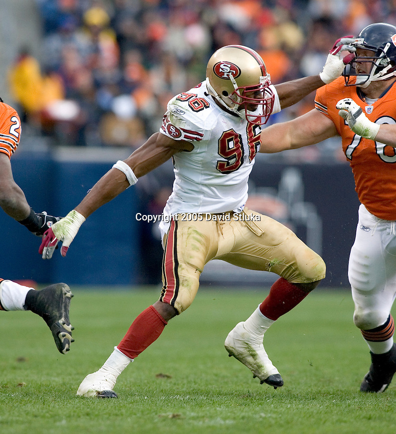 Linebacker Andre Carter #96 of the San Francisco 49ers battles offensive lineman John Tait #96 the Chicago Bears on November 13, 2005 at Soldier Field in Chicago, Illinois. The Bears defeated the 49ers 17-9. (Photo by David Stluka)