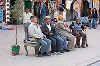 Bodhnath, Nepal.  Old Men Talking Opposite the Stupa.