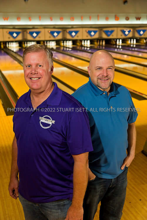 12/18/2013&mdash;Seattle, WA, USA<br /> <br /> Mike Gubsch (left) and Andy Carl (right), owners of West Seattle in Bowl in Seattle, Washington.<br /> <br /> Established August 25, 1948, West Seattle Bowl has become part of the fabric of the West Seattle Community.   The 14 lane center expanded to 32 lanes in 1959.  Upgrades over the years include a state-of-the-art scoring system, new furniture and d&eacute;cor, bumpers for kids on every lane, new synthetic lanes and a private meeting space for 18. The new Highstrike Grill restaurant, added in 2011, has received rave reviews.<br /> <br /> Current owners Michael Gubsch and Andrew Carl have a combined experience of 75 years in the bowling industry.<br /> <br /> Photograph by Stuart Isett. <br /> &copy;2013 Stuart Isett. All rights reserved.