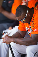 Michael Burgess (25) of the Bowie Baysox tapes the handle of his bat during the game against the Richmond Flying Squirrels at The Diamond on May 24, 2015 in Richmond, Virginia.  The Flying Squirrels defeated the Baysox 5-2.  (Brian Westerholt/Four Seam Images)