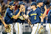Michigan Wolverines shortstop Jack Blomgren (2) celebrates with teammate Willie Weiss (2) after Game 6 of the NCAA College World Series against the Florida State Seminoles on June 17, 2019 at TD Ameritrade Park in Omaha, Nebraska. Michigan defeated Florida State 2-0. (Andrew Woolley/Four Seam Images)