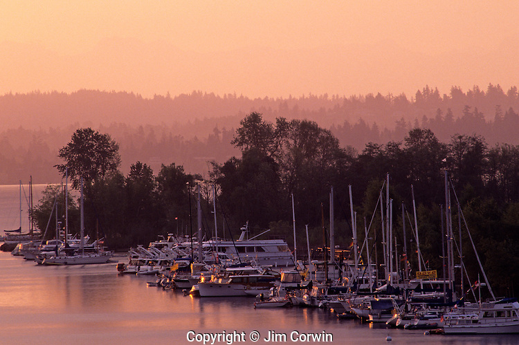 Opening Day of boating along the Montlake Cut with boats lined up on Union Bay sunrise  Seattle Washington State USA.