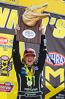 Mar 20, 2016; Gainesville, FL, USA; NHRA top fuel driver Brittany Force celebrates after winning the Gatornationals at Auto Plus Raceway at Gainesville. Mandatory Credit: Mark J. Rebilas-USA TODAY Sports
