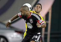 WASHINGTON, DC - AUGUST 4, 2012:  Maicon Santos (29) of DC United goes up for a header against Carlos Mendes (4) of the Columbus Crew during an MLS match at RFK Stadium in Washington DC on August 4. United won 1-0.
