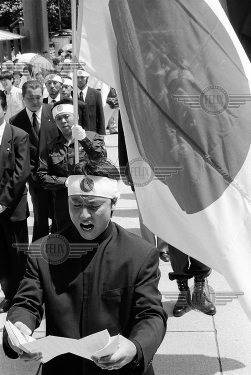 A group of right-wingers parading the Japanese flag in front of Yasukuni Shrine, the Imperial Shrine for Japan's war dead, on August 15th - marking the day that Japan surrendered to the Allies at the end of the Second World War.