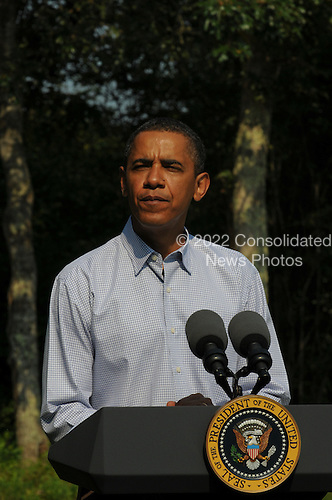 Chilmark, MA - August 26, 2009 -- United States President Barack Obama delivers a statement on the death of U.S. Senator Edward M. Kennedy (Democrat of Massachusetts)  at his vacation rental home in Chilmark, Massachusetts on the island of Martha's Vineyard, Wednesday, August 26, 2009.  .Credit: Neal Hamberg - Pool via CNP