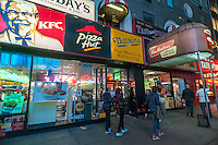 Signs for an assortment of fast food franchises located in one storefront in New York on Tuesday, April 28, 2015. (© Richard B. Levine)