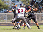 Palos Verdes, CA 09/19/14 - Johnny Kimura (Peninsula #64), \t62\ and Daniel Schubert (Peninsula #18)in action during the Torrance-Palos Verdes Peninsula CIF Varsity football game at Peninsula High School.  Torrance defeated Peninsula 47-21