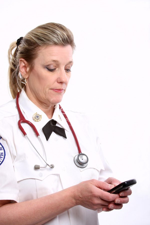 A Wisconsin EMT texting on a cell phone