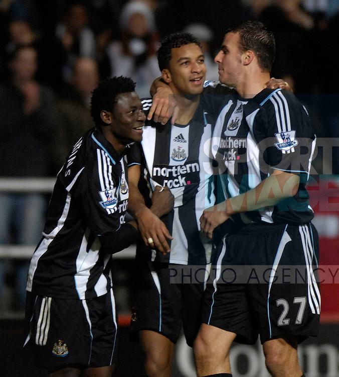 Newcastle's Habib Beye celebrates Obfemi Martins and Steve Taylor.