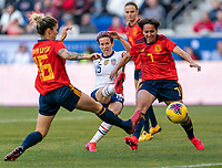 HARRISON, NJ - MARCH 08: Megan Rapinoe #15 of the United States takes a shot past Marta Corredera #7 of Spain during a game between Spain and USWNT at Red Bull Arena on March 08, 2020 in Harrison, New Jersey.