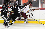 Tim Schaller (Providence - 11), Steven Shamanski (PC - 28), Quinn Smith (BC - 27) - The Boston College Eagles defeated the visiting Providence College Friars 4-1 (EN) on Tuesday, December 6, 2011, at Kelley Rink in Conte Forum in Chestnut Hill, Massachusetts.