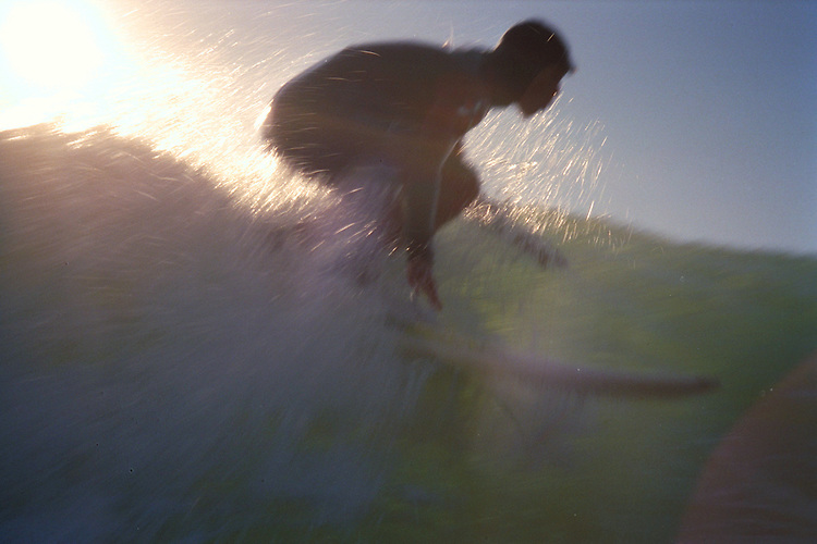 Surfer in the sun, Mendocino Coast, CA. CD scan from 35mm slide film.  © John Birchard