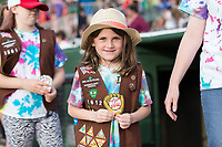A young girl scout proudly shows off the patch she received prior to parading around the warning track at Kannapolis Intimidators Stadium before the game on April 22, 2017 in Kannapolis, North Carolina.  The Intimidators defeated the Crawdads 10-9 in 12 innings.  (Brian Westerholt/Four Seam Images)