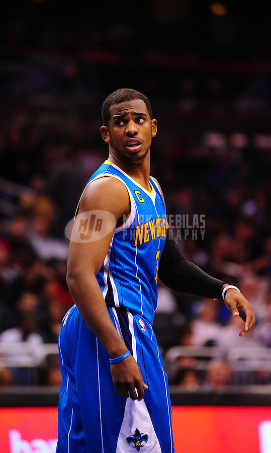 Feb. 11, 2011; Orlando, FL, USA; New Orleans Hornets guard (3) Chris Paul against the Orlando Magic at the Amway Center. The Hornets defeated the Magic 99-93. Mandatory Credit: Mark J. Rebilas-