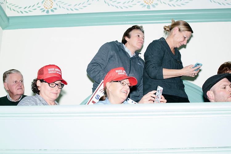People watch as real estate mogul and Republican presidential candidate Donald Trump speaks at a rally at Exeter Town Hall in Exeter, New Hampshire, on Thurs., Feb. 4, 2016.