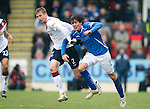 St Johnstone v Rangers...14.01.12  .Dorin Goian blocks off the run of Fran Sandaza.Picture by Graeme Hart..Copyright Perthshire Picture Agency.Tel: 01738 623350  Mobile: 07990 594431