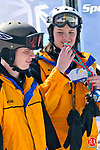 NEW HARTFORD, CT- 28 February 2009 --022809JS11-Brandon Poulin of Waterbury, left and his ski partner Grace Schreiber receive their gold medals after winning the unified giant slalom in the Special Olympics Connecticut 2009 Winter Games at Ski Sundown in New Hartford on Saturday. Ski Sundown was just one of four venues throughout the state for the winter games this weekend. Competition continues today (Sunday) starting at 9 a.m.<br /> Jim Shannon Republican-American