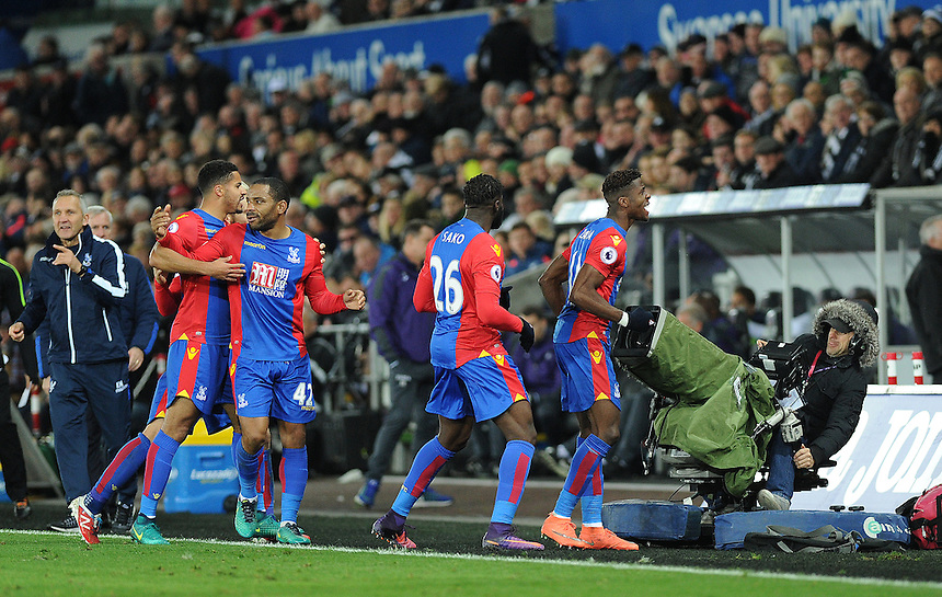 CELE - Crystal Palace's Wilfried Zaha celebrates scoring his sides third goal <br /> <br /> Photographer Ashley Crowden/CameraSport<br /> <br /> The Premier League - Swansea City v Crystal Palace - Saturday 26th November 2016 - Liberty Stadium - Swansea <br /> <br /> World Copyright &copy; 2016 CameraSport. All rights reserved. 43 Linden Ave. Countesthorpe. Leicester. England. LE8 5PG - Tel: +44 (0) 116 277 4147 - admin@camerasport.com - www.camerasport.com