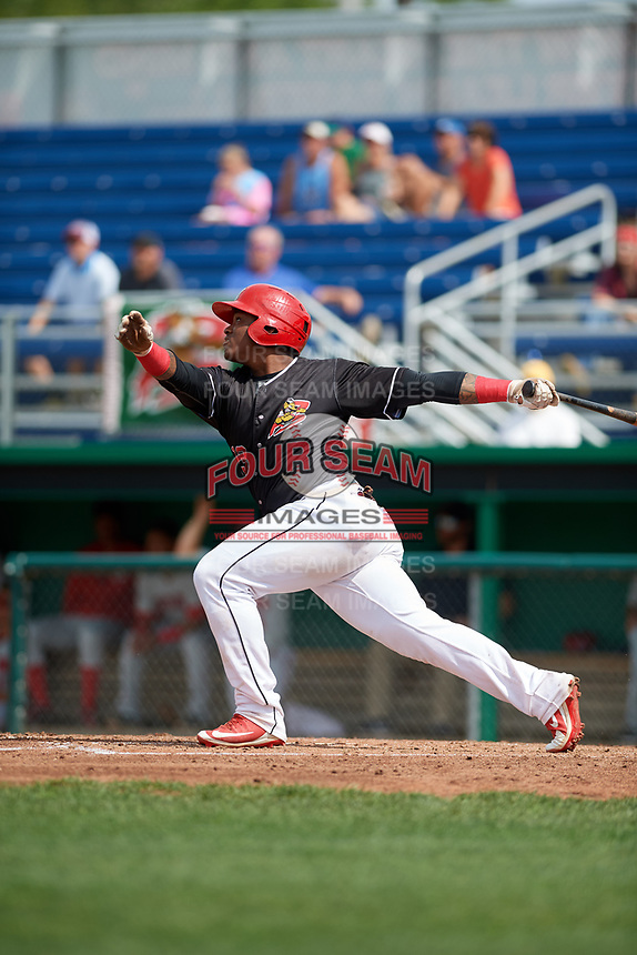 Batavia Muckdogs right fielder Albert Guaimaro (13) follows through on a swing during a game against the Auburn Doubledays on September 1, 2018 at Dwyer Stadium in Batavia, New York.  Auburn defeated Batavia 10-5.  (Mike Janes/Four Seam Images)