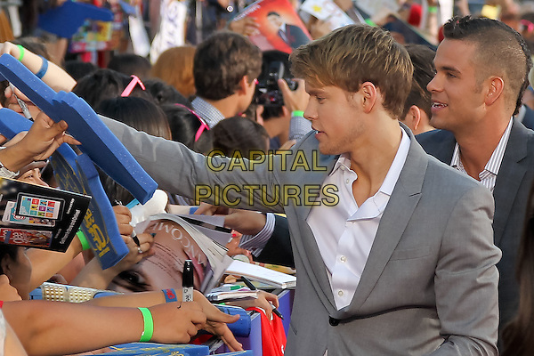 CHORD OVERSTREET, MARK SALLING.The 20th Century Fox 'Glee 3D' Concert World Movie Premiere held at The Regency Village theatre in Westwood, California, USA,.August 6th 2011..half length jacket side profile fans crowd audience signing autographs grey gray .CAP/CEL.©CEL/Capital Pictures