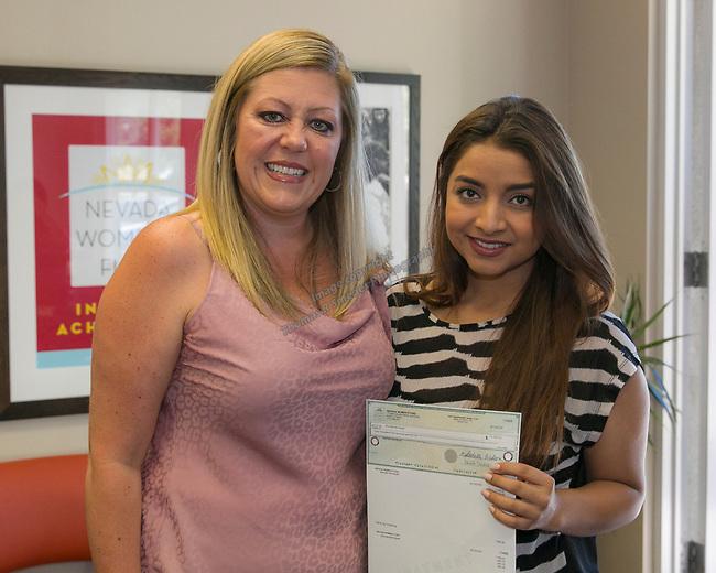 Brenda Henriquez, right, and Board Member Amanda Alfaro during the Nevada Women's Fund Scholarship distribution, June 20, 2019.