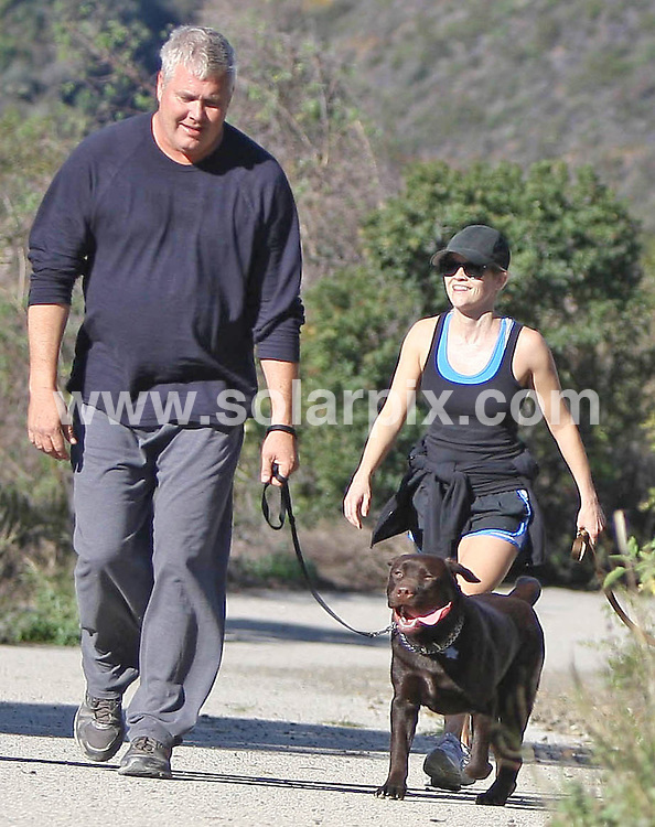 **ALL ROUND PICTURES FROM SOLARPIX.COM**                                             **SYNDICATION RIGHTS FOR UK, AUSTRALIA, DENMARK, PORTUGAL, S. AFRICA, SPAIN & DUBAI (U.A.E) & ASIA (EXCLUDING JAPAN) ONLY**                                                                                  Caption:  Reese Witherspoon goes for a walk with her dogs In Brentwood, CA, USA. 13 January 2011                                                                    This pic: Reese Witherspoon                                                                                        JOB REF: 12665 PHZ Candids      DATE: 13_01_2011                                                           **MUST CREDIT SOLARPIX.COM OR DOUBLE FEE WILL BE CHARGED**                                                                      **MUST AGREE FEE BEFORE ONLINE USAGE**                               **CALL US ON: +34 952 811 768 or LOW RATE FROM UK 0844 617 7637**