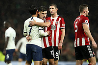 9th November 2019; Tottenham Hotspur Stadium, London, England; English Premier League Football, Tottenham Hotspur versus Sheffield United; John Egan of Sheffield United consoles Son Heung-Min of Tottenham Hotspur after the 1-1 draw - Strictly Editorial Use Only. No use with unauthorized audio, video, data, fixture lists, club/league logos or 'live' services. Online in-match use limited to 120 images, no video emulation. No use in betting, games or single club/league/player publications